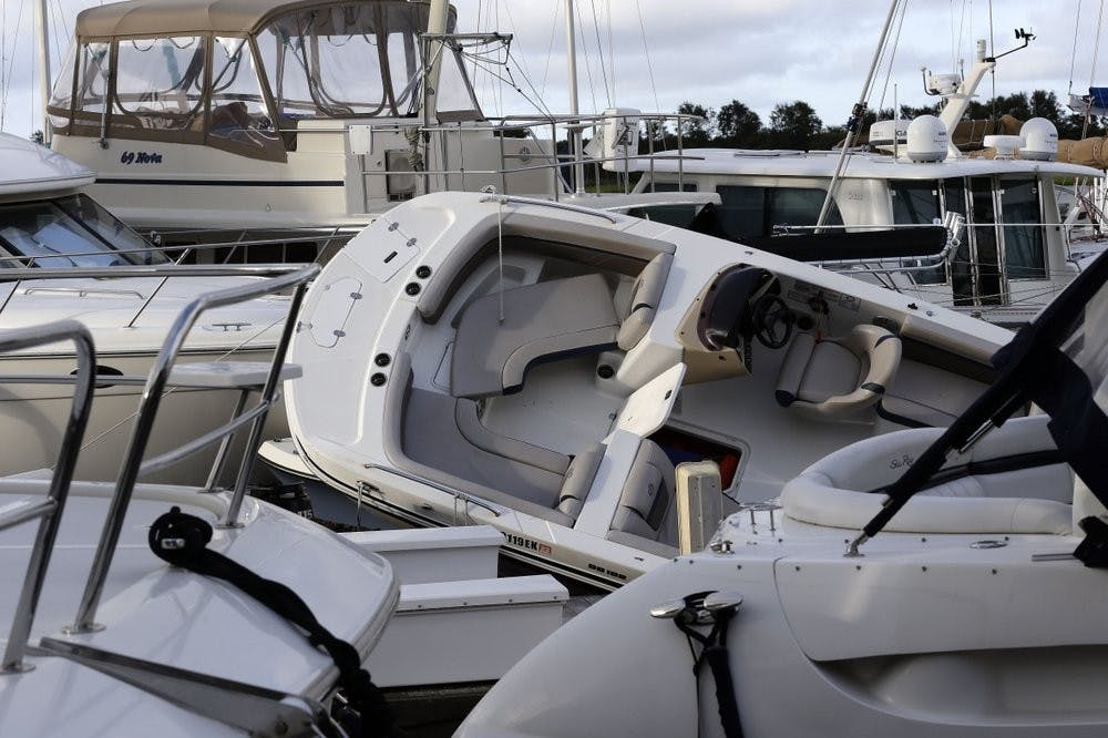 <p>Boats are piled on each other at the Southport Marina following the effects of Hurricane Isaias in Southport, N.C., Tuesday, Aug. 4, 2020. (AP Photo/Gerry Broome)</p>