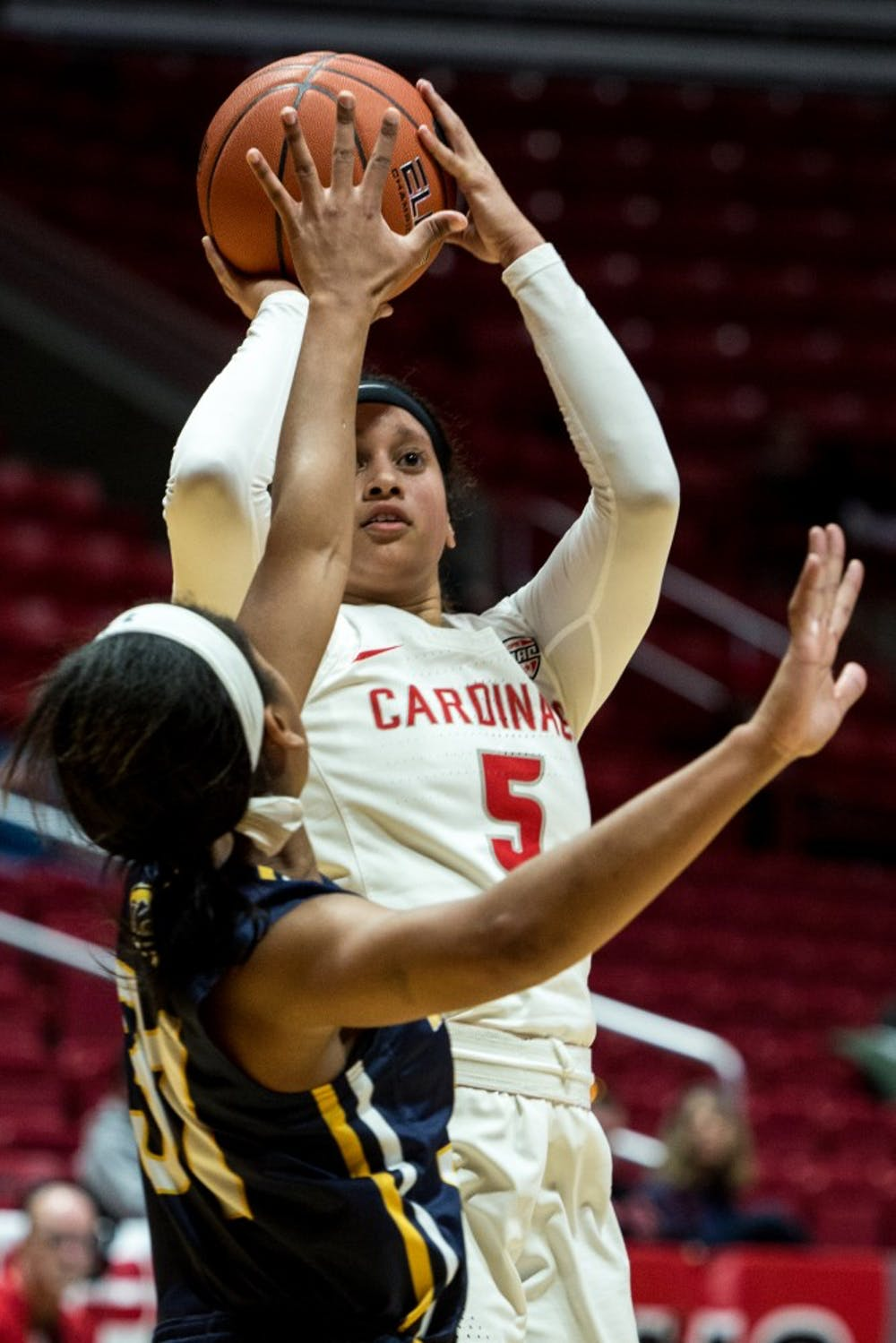Ball State guard Maliah Howard-Bass sinks a pull up jump shot over Kent State guard Megan Carter in John E. Worthen Arena to keep their lead in the first half of the game Jan. 23, 2019. The women's basketball game was close up until the last few minutes when Ball State took a lead to win 48-44. Eric Pritchett,DN