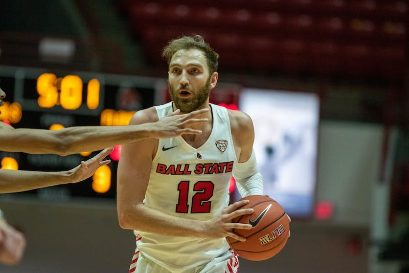 Redshirt senior guard Brachen Hazen holds the ball Dec. 5, 2020, in Worthen Arena. Hazen had 1 assist against the University of Illinois at Chicago Flames. Jaden Whiteman, DN