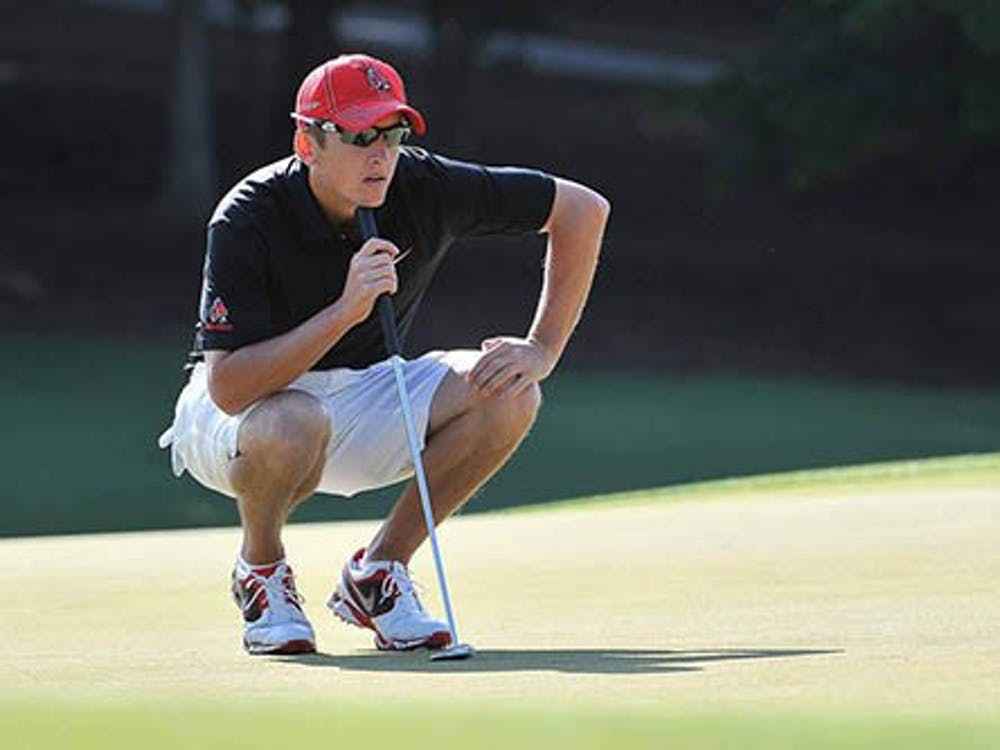 Senior Joe Gasser lines up his put during the NCAA Nationals in Atlanta, Ga. Even though the Cardinals started strong in the rankings, they fell to 24th in overall due to tough course conditions. PHOTO PROVIDED BY BSU ATHLETICS
