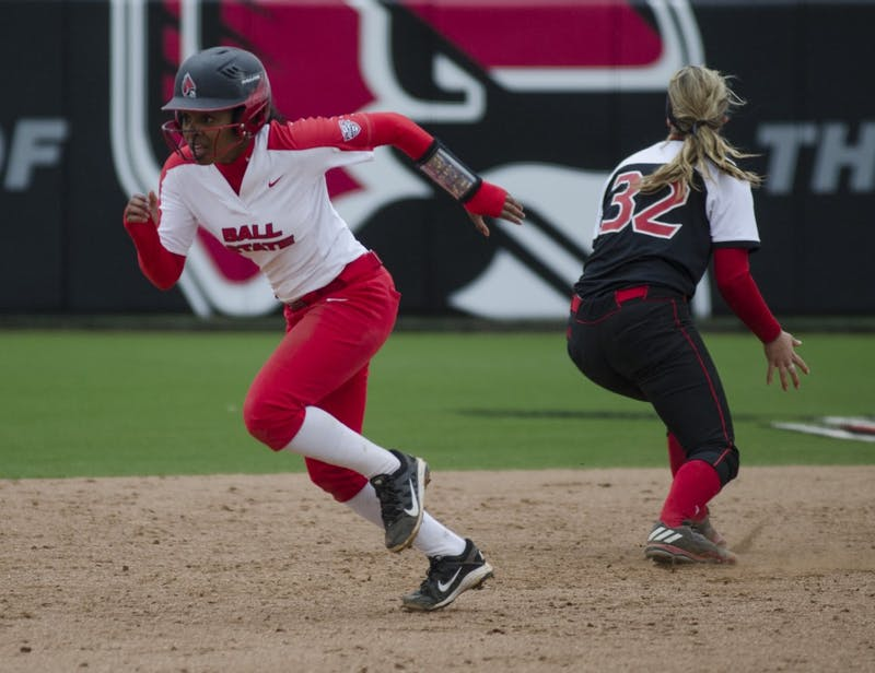 Sophomore pinch runner Aeshia Miles runs to third base during the second game of the double-header against Northern Illinois on April 4 at the Softball Field at the First Merchants Ballpark Complex. Ball State won the first game 3-2 and the second game 6-4. Emma Rogers // DN