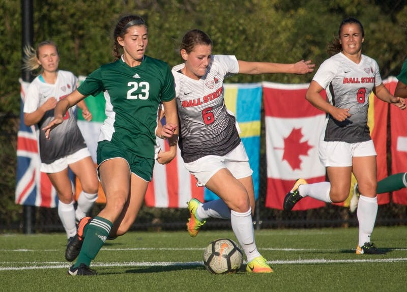 Senior Lucy Walton pushes against Eastern Michigan University player Lindsey Shira on Oct. 13 at Briner Sports Complex. Walton is a midfielder and defender for Ball State University. Rebecca Slezak,DN