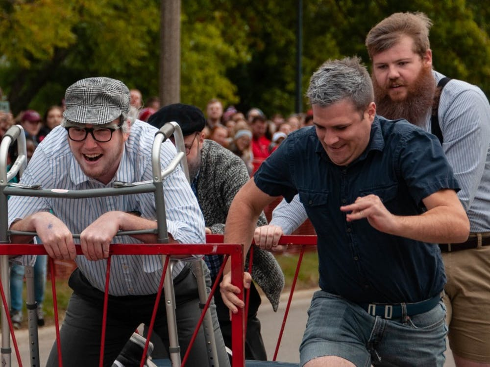 Housing and Residence Life faculty members compete in Bed Races, the annual Homecoming event Oct. 19, 2018, on Riverside Ave. in Ball State's campus. The team won for fastest time in the faculty category. Madeline Grosh,DN