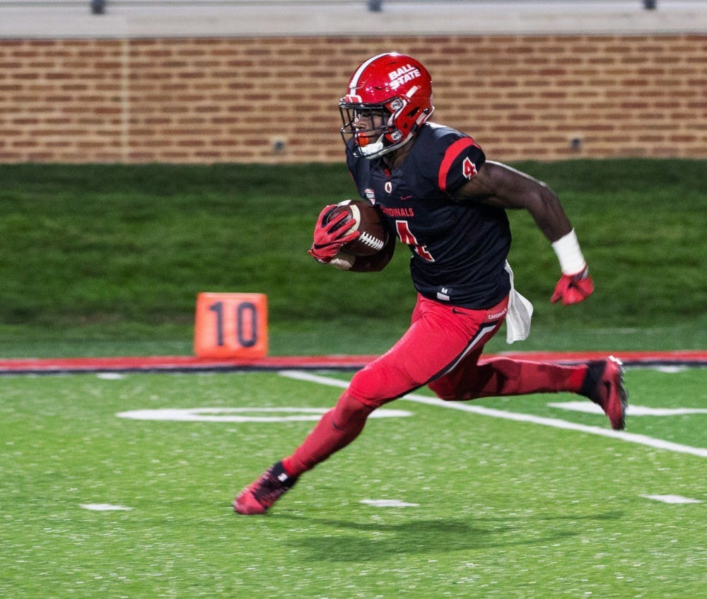 Sophomore running back Malik Dunner runs the ball down the field during the Cardinals' game against Toledo on Oct. 26 at Scheumann Stadium. Dunner had 62 rushing yards for gain. Ian Elliott, DN File