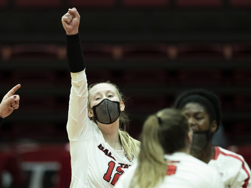 Cardinals freshman outside hitter Cait Snyder celebrates with her team after scoring a point against Central Michigan University March 19, 2021, at John E. Worthen Arena. The Cardinals beat the Chippewas 3-2. Jacob Musselman, DN