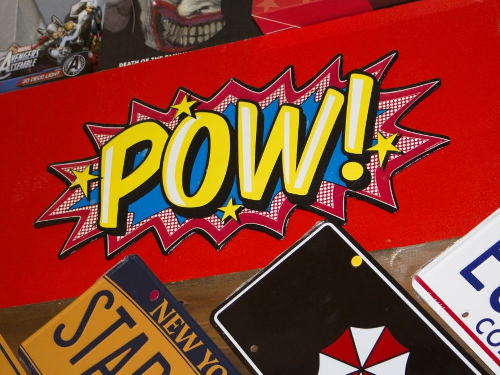 """A """"Pow!"""" sign hangs in Aw Yeah Comics on March 17. The shop is full of comic references such as this. (Briana Hale // DN)"""