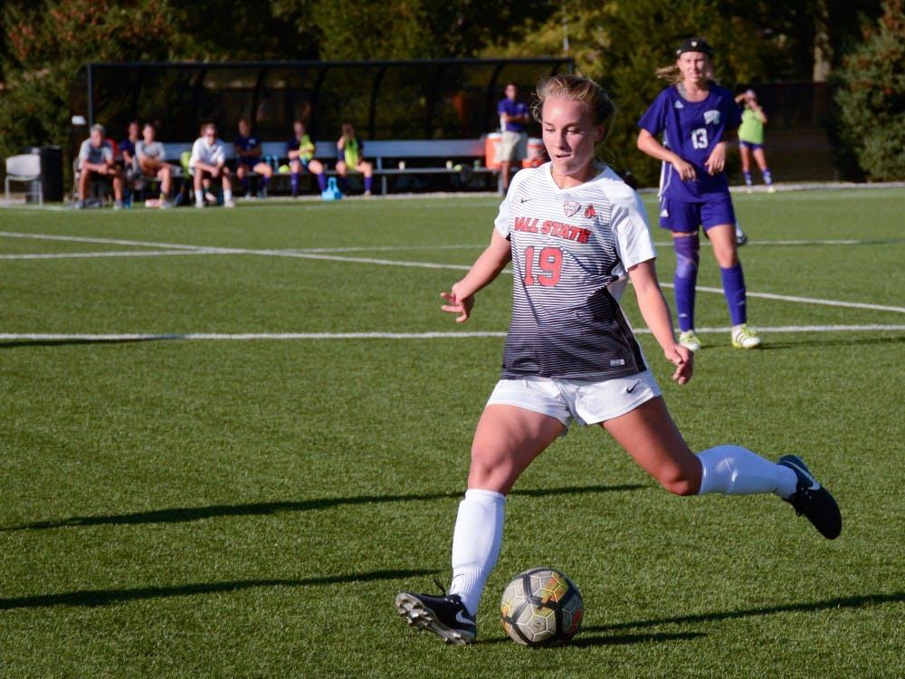 Junior midfielder Lauren Lerew kicks the ball upfield on Sept 15 at the game against Western Illinois in Briner Sports Complex. The Cardinals won 3-0. Harrison Raft, DN File