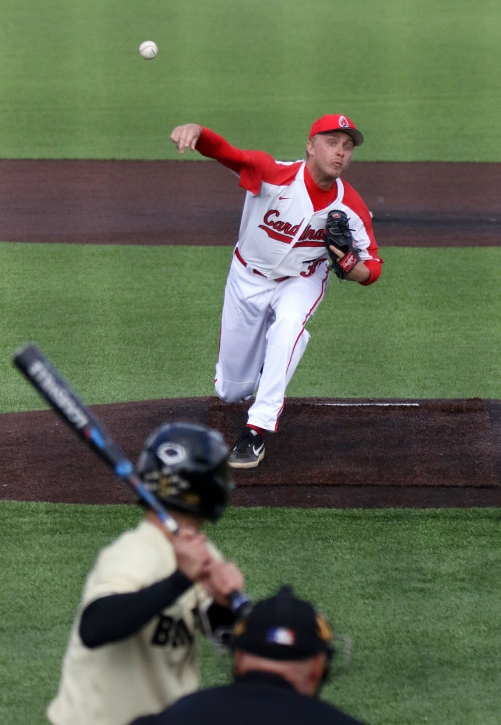 Ball State redshirt senior right-handed pitcher Brendan Burns pitches to Purdue freshman shortstop Evan Albrecht during the Cardinals' game against the Boilermakers March 19, 2019 at Ball Diamond at First Merchants Ballpark Complex in Muncie, IN. Burns started pitching for the Cardinals in the third inning. Paige Grider, DN