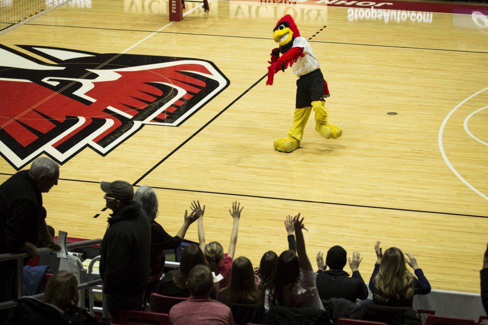 <p>Charlie Cardinal throws t-shirts to a crowd of fans during halftime of the Men's Volleyball game against Ball State and the Emmanuel Lions, Jan. 6, at John E. Worthen Arena. Admission is free to students and fans in the Muncie community. <strong>Grace Hollars, DN</strong></p>