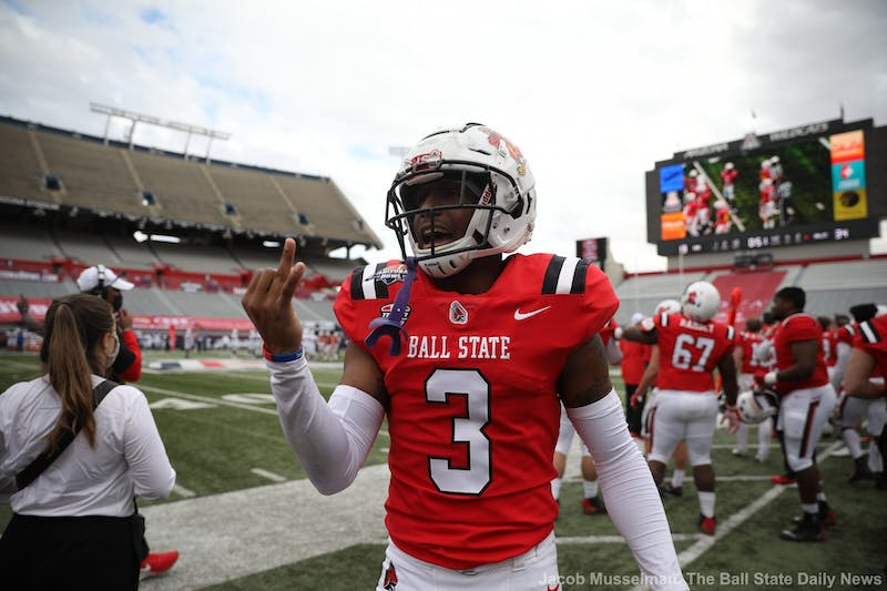 Ball State Cardinals junior cornerback Amechi Uzodinma II celebrates by holding up two fingers for the two championship rings they won during the 2020 season, one for the Mid American Conference Championship and one for winning the Arizona Bowl Dec. 31, 2020, at Arizona Stadium in Tucson, Arizona. The Cardinals won 34-13. Jacob Musselman, DN
