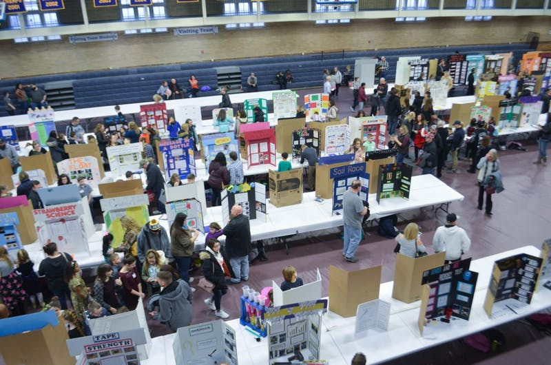 People look at several students' science fair projects at the East Central Indiana Science Fair Saturday, Feb. 16 in Ball Gym.  Students who placed in each division will move on to the state science fair later this year. Jacob Musselman, DN