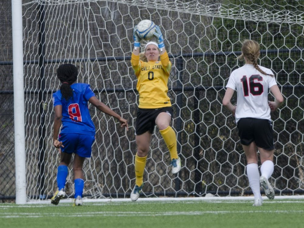 Sophomore goalie Alyssa Heintschel catches an attempt from the Haiti National team during the game on April 12 at the Briner Sports Complex. DN PHOTO BREANNA DAUGHERTY