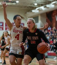 Sophomore forward Thelma Dis Agustdottir charges IUPUI Junior guard Holly Hoopingarner Nov. 5, 2019, in the IUPUI Gymnasium in Indianapolis, Ind. Hoopingarner had eight points against the Cardinals. Jacob Musselman, DN