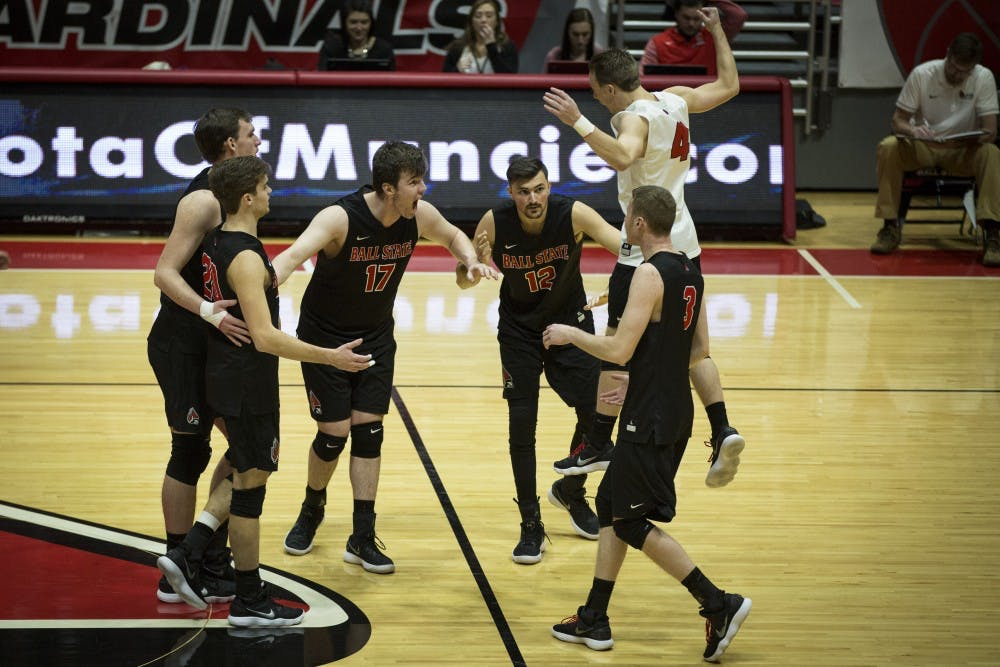 <p>Ball State players jump to a huddle after scoring two points in a row against the Lions, Jan. 6, at John E. Worthen Arena. Ball State swept the Lions, in three straight sets, 16-25, 15-25, 12-25. <strong>Grace Hollars, DN&nbsp;</strong></p>