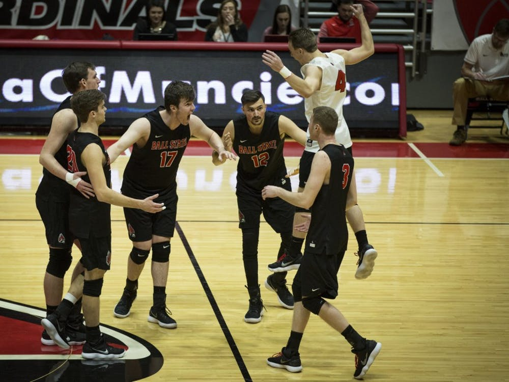 Ball State players jump to a huddle after scoring two points in a row against the Lions, Jan. 6, at John E. Worthen Arena. Ball State swept the Lions, in three straight sets, 16-25, 15-25, 12-25. Grace Hollars, DN