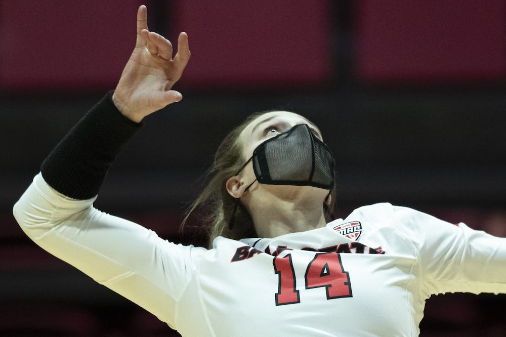Cardinals senior outside hitter Kia Holder serves the ball during set one against Central Michigan University March 19, 2021, at John E. Worthen Arena. The Cardinals beat the Chippewas 3-2. Jacob Musselman, DN