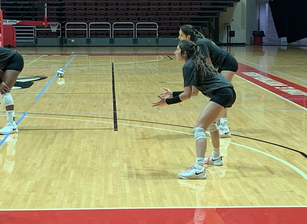 Kate Avila prepares to receive the serve at practice on Oct. 29. Avila reached 2,000 career digs this past weekend and hopes to continue to add to the total.