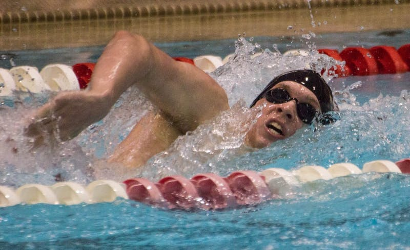 Sophomore Alec Tuthill swims in the 200m freestyle during the senior meet against Notre Dame on Feb. 4 in Lewellen Pool. Tuthill finsihed sixth with a time of 1:48:85. Grace Ramey // DN