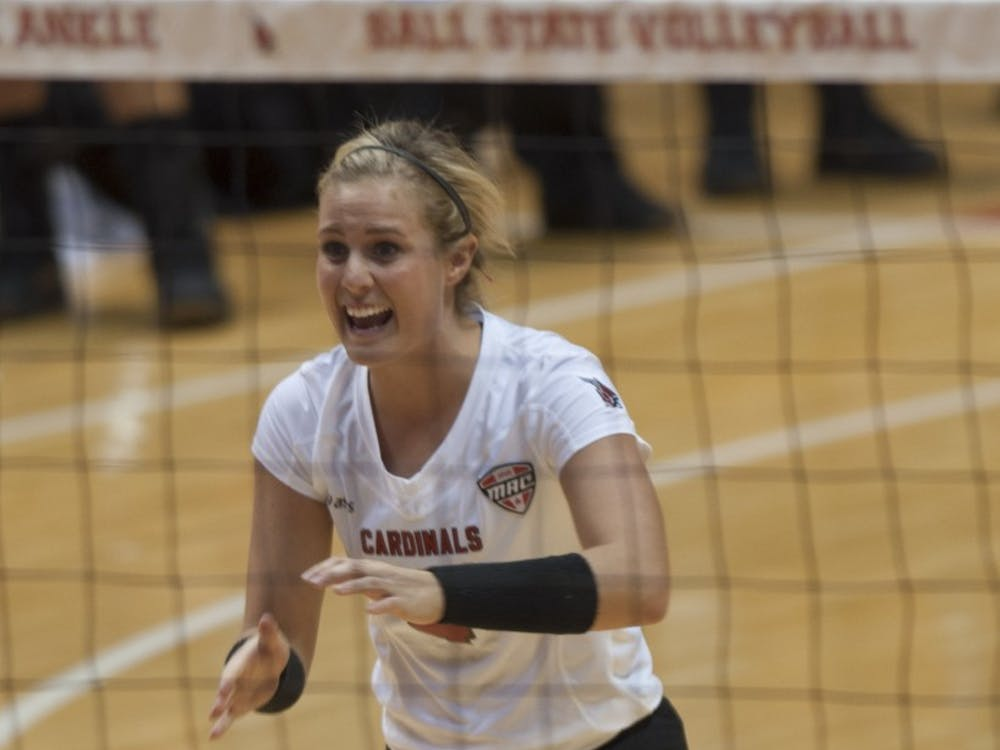 Sophomore defensive specialist Kati Vasalakis moves to celebrate with her team against Bowling Green State University on Oct. 25 at Worthen Arena. Vasalakis had nine digs in the 3-1 loss. DN PHOTO MATT McKINNEY