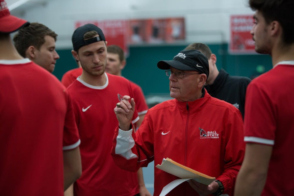 <p>Head coach Bill Richards talks to his team to get them ready for the singles matches against the University of Toledo at the Northwest YMCA in Muncie on March 24. Ball State won 5-2. <strong>Eric Pritchett, DN</strong></p>