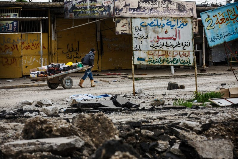 A local vegetable seller pulls his cart through war-torn neighborhoods of West Mosul, Nineveh Province, on March 19, 2017.  (Marcus Yam/Los Angeles Times/TNS)