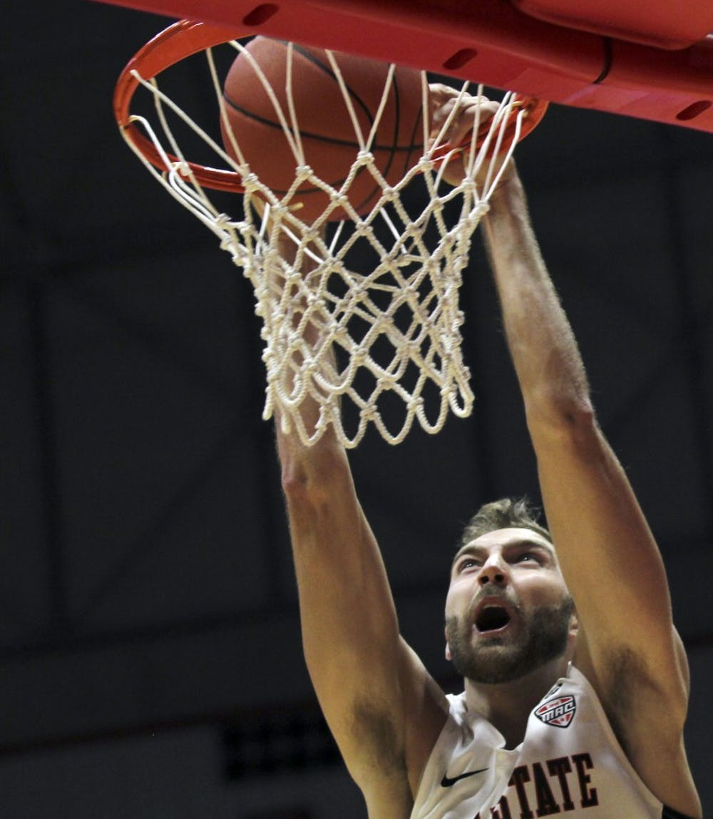 Ball State redshirt sophomore forward Brachen Hazen dunks the ball during the Cardinals' exhibition game against Indianapolis Nov. 2, 2018, in John E. Worthen Arena. Ball State won 92-76. Paige Grider, DN