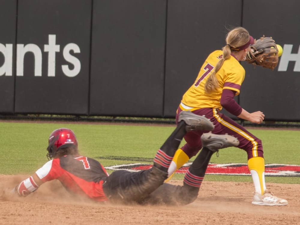 Ball State sophomore Kennedy Wynn, left, slides into second base while Central Michigan's Rachel Vieira catches the ball during the first game against the Chippewas April 21 at the softball field at First Merchant's Ballpark Complex. Ball State won the first game 2-1. Briana Hale, DN