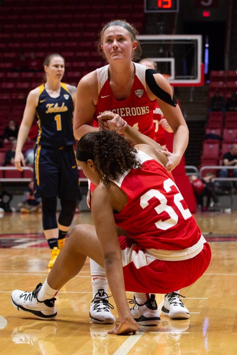 Senior Jasmin Samz helps Sophomore Oshlynn Brown get up during the game against Toledo in John E. Worthen Arena Feb. 23, 2019. The Hoosieroons lost to the Rockets 63-62. Scott Fleener, DN