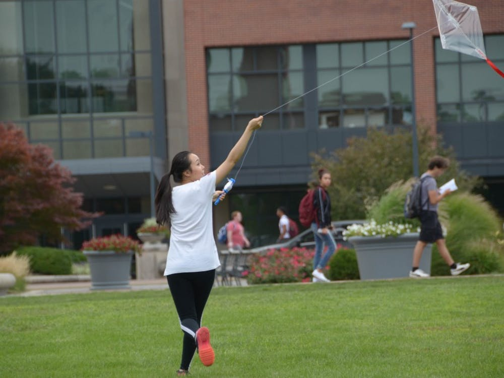 Di Yang flies a kite she built for her class within the landscape architecture masters program on Aug. 24. Adam Pannel, DN