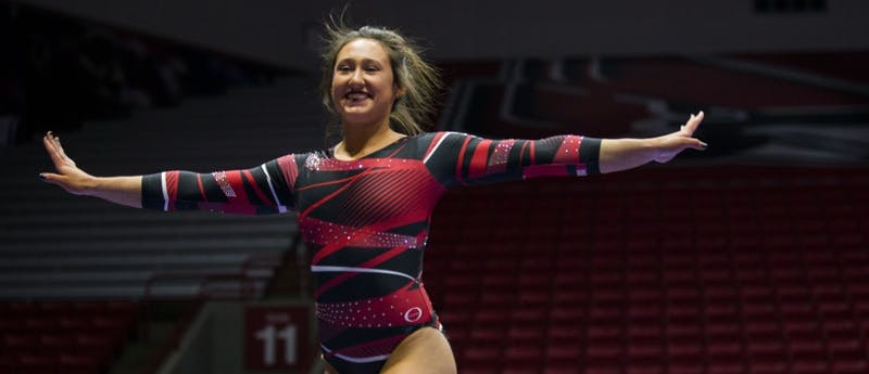 Freshman Bri Slonim smiles toward the crowd and judges during her routine on the balance beam during the meet against Northern Illinois on Jan. 15 at Worthen Arena. Slonim places second with a score of 9.725. Breanna Daugherty // DN