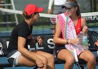 Graduate Assistant Carmen Blanco talks to senior Sarah Swinderski during her first round of singles matches against Detroit Mercy at Cardinal Creek Tennis Center. Swinderski won the first set of the match 6-4. Patrick Murphy,DN
