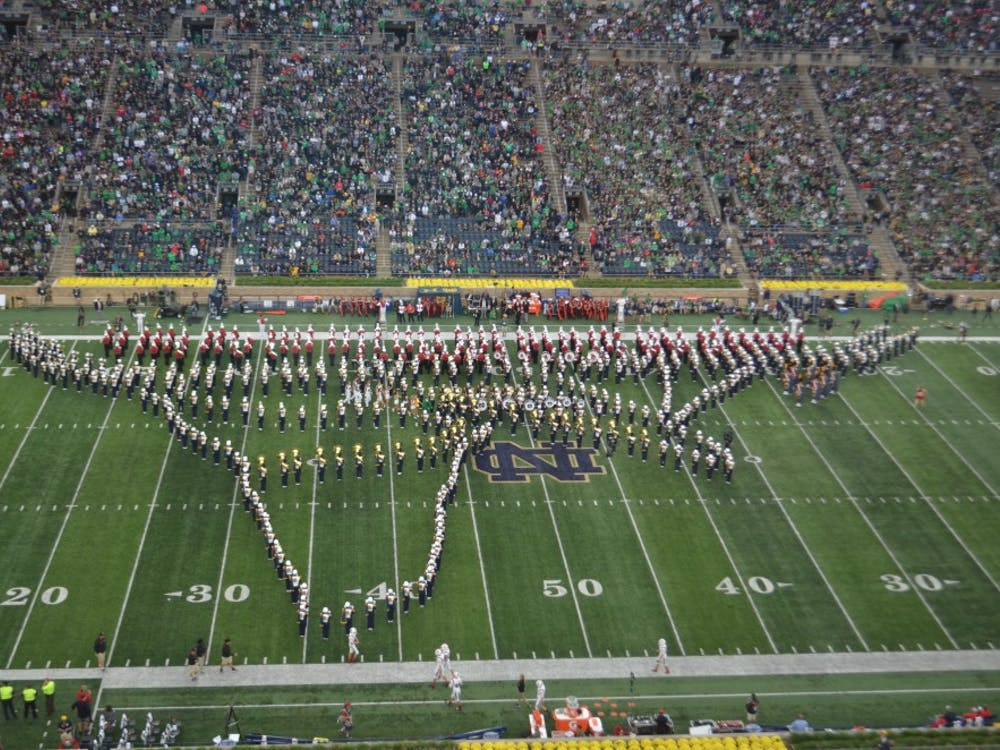 The Ball State and Notre Dame marching bands join in a performance during halftime at the game Saturday, Sept. 8, 2018, at Notre Dame Stadium. The Irish won the teams' first meeting in history, 24-16. Zach Piatt,DN