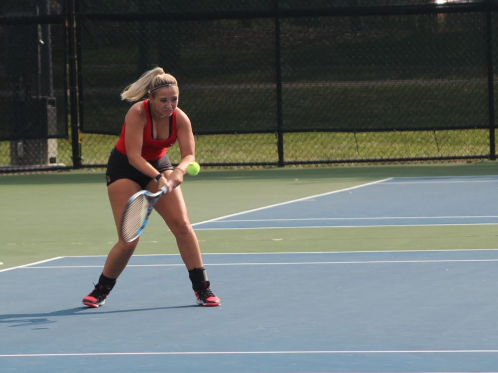 Senior Peyton Gollhofer attempts to return the ball back to her Detroit Mercy opponent in her singles match. Peyton enters this fall season with a singles overall record of 45-26. Patrick Murphy,DN