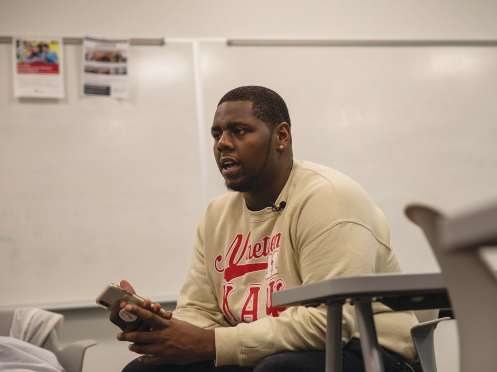 "Senior business administration major, Sultan ""Mufasa"" Benson, gets interviewed by NewsLink Indiana Jan. 22. 2020, in a Whitinger Business Building classroom. Benson's Marketing 310 professor, Shaheen Borna, called the police on him after he refused to change seats because he was charging his laptop. Jaden Whiteman, DN"