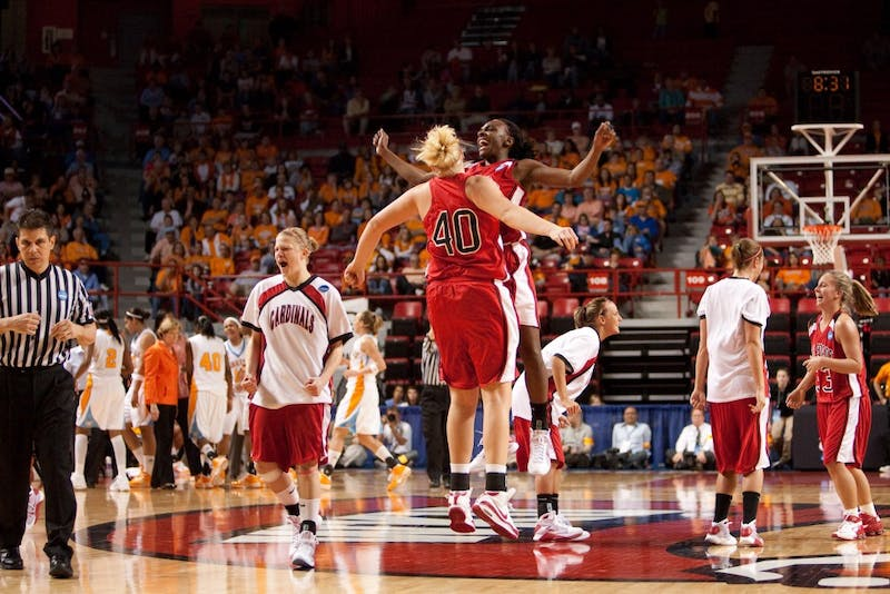 Amber Crago celebrates with a teammate after No. 12 Ball State upset No. 5 Tennessee in the first round of the 2009 NCAA Division I Women's Basketball Tournament on Mar. 22, 2009 at E.A. Diddle Arena. Ball State Photo Services, Photo Provided