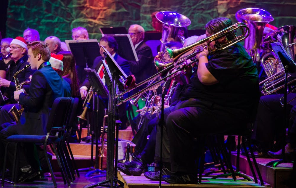 """America's Hometown Bands perform """"The Joyous Notes of Christmas"""" on Dec 6 at Emens Auditorium. The concert was introduced by Terry Whitt Bailey, Muncie's Director of Community Development. DN PHOTO KELLEN HAZELIP"""