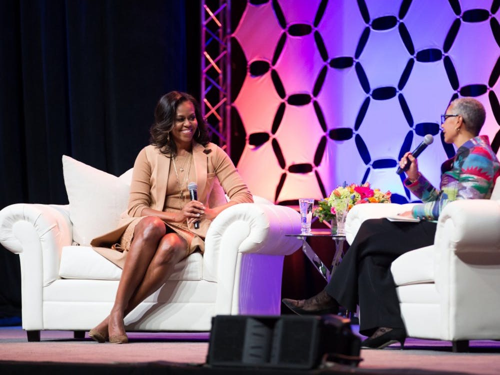 Former First Lady Michelle Obama speaks to moderator Alecia DeCoudreaux Feb. 13 at Bankers Life Fieldhouse in Indianapolis. More than 12,000 people attended the evening event. Daniel Arthur Jacobson, Photo Courtesy