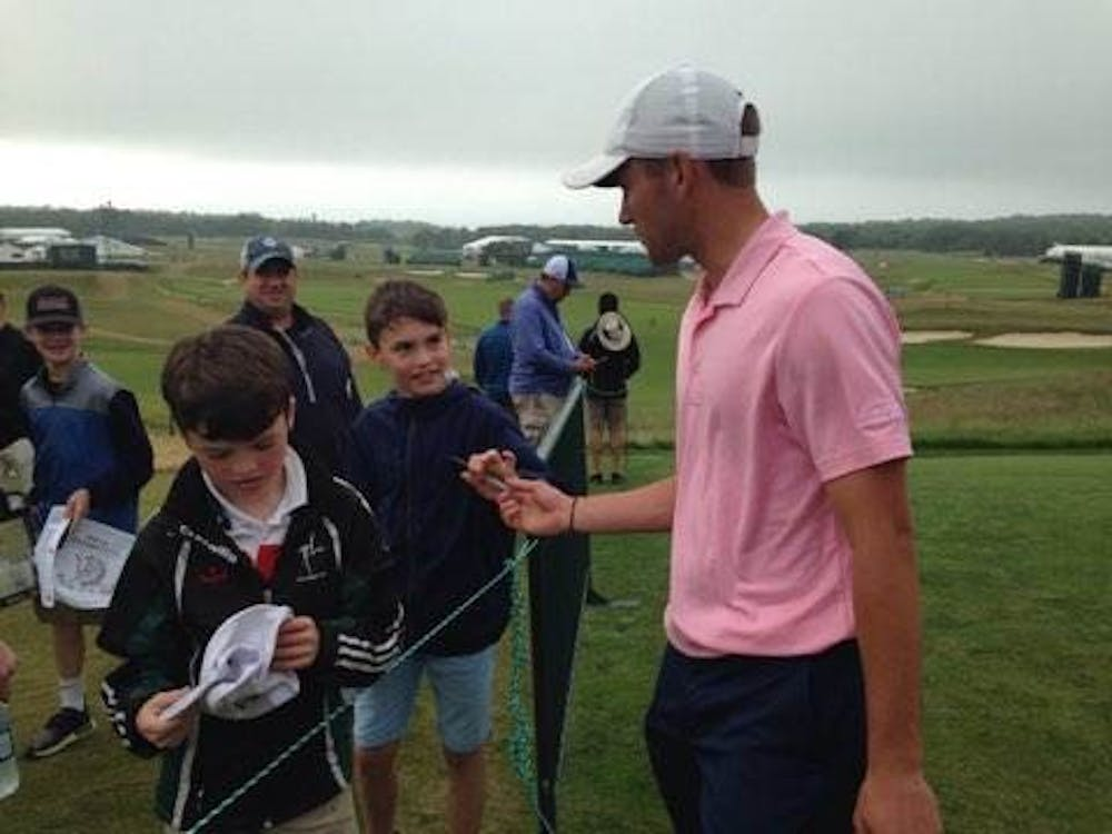 Timothy Wiseman signs autographs for fans at the U.S. Open. Wiseman is the first Ball State golfer to qualify for a major tournament while still in school. Timothy Wiseman, Photo Provided