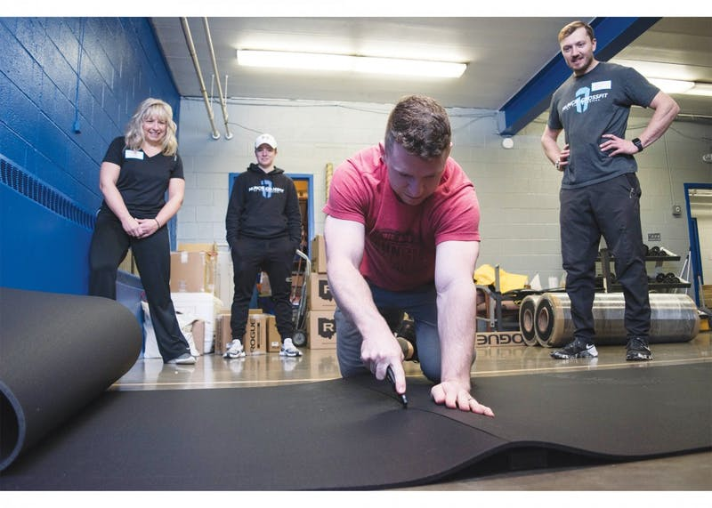 Volunteers from Muncie Crossfit reconstruct the gym room at the Boys & Girls Clubs of Muncie (BGC), Jan. 17, 2019, with new equipment and new matting. The BGC of Muncie has raised more than $56,500 of their $85,000 goal. Stephanie Amador, DN