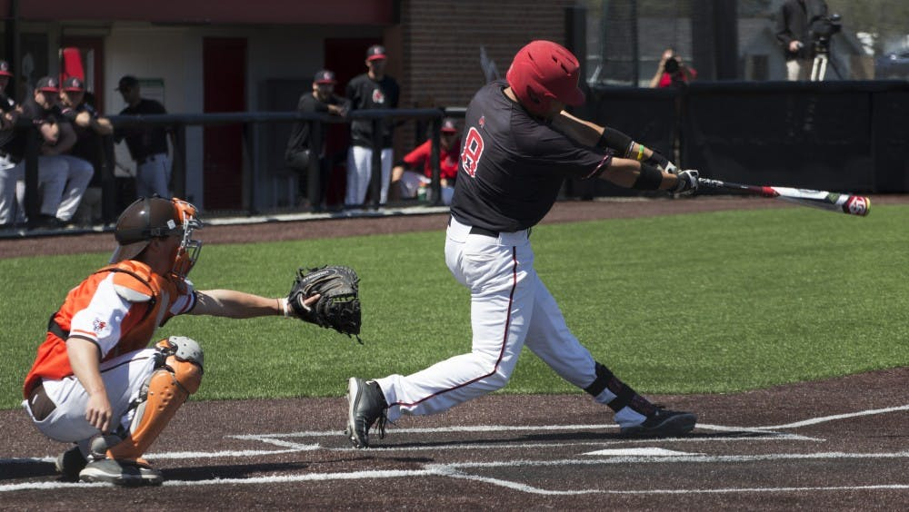 Alex Call, a junior outfielder for the Ball State Cardinals, attempts to hit the ball during the game against Bowling Green on April 23. DN PHOTO GRACE RAMEY