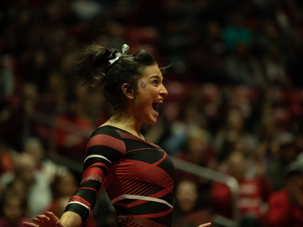 Junior Claudia Goyco celebrates after finishing her floor routine, Jan. 26, 2020, in John E. Worthen Arena. Goyco scored 9.900 in her event. Jacob Musselman, DN