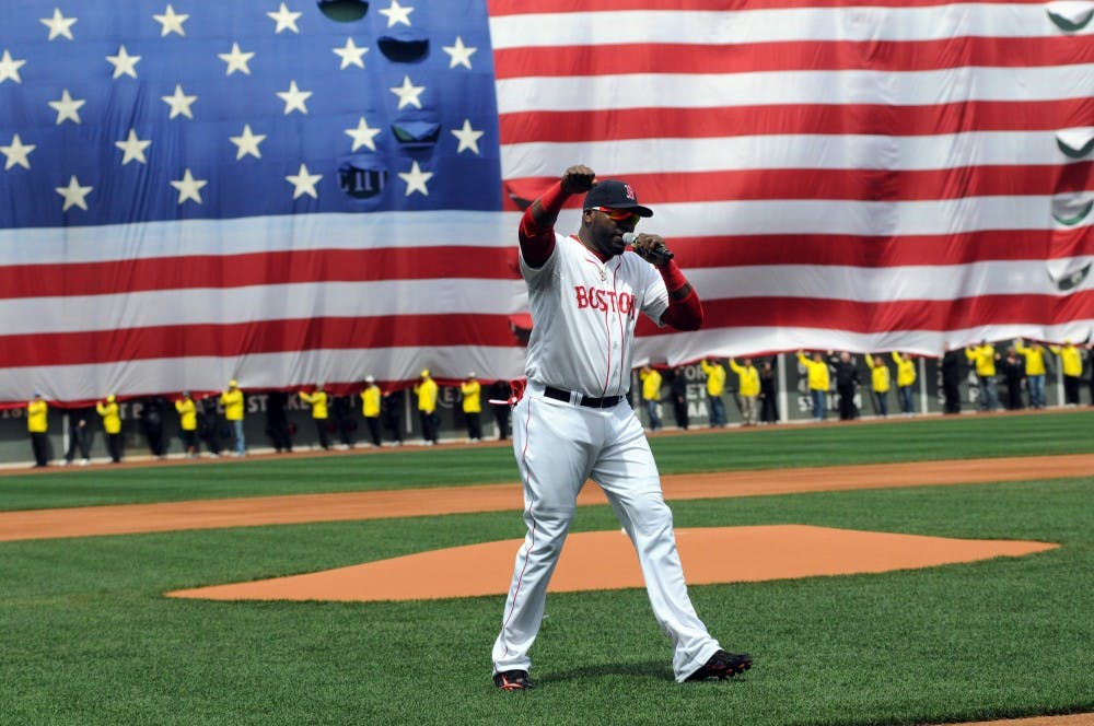 Boston's Big Papi addresses the crowd on Saturday, April 20, 2013, during the Red Sox versus Kansas City Royals opening day ceremony, which paid tribute to the victims of the Boston Marathon in Boston, Massachusetts. (Faith Ninivaggi/Boston Herald/MCT/TNS)