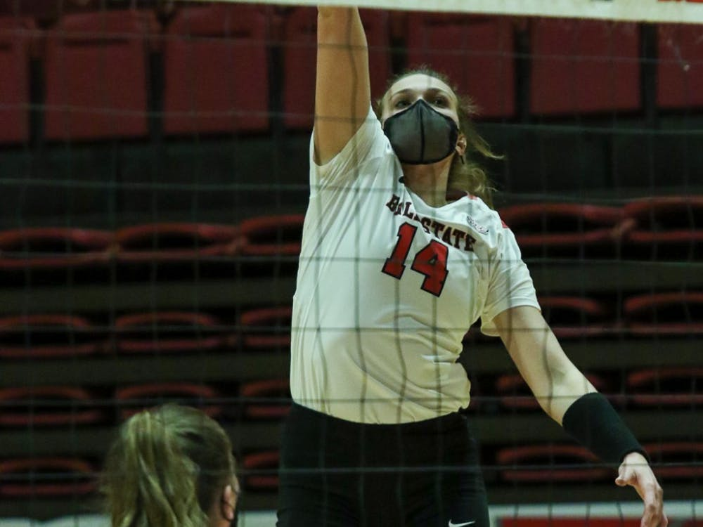 Senior outside hitter Kia Holder hits the ball. The Cardinals fell to the Chippewas 3-1. Gabi Kramer, DN