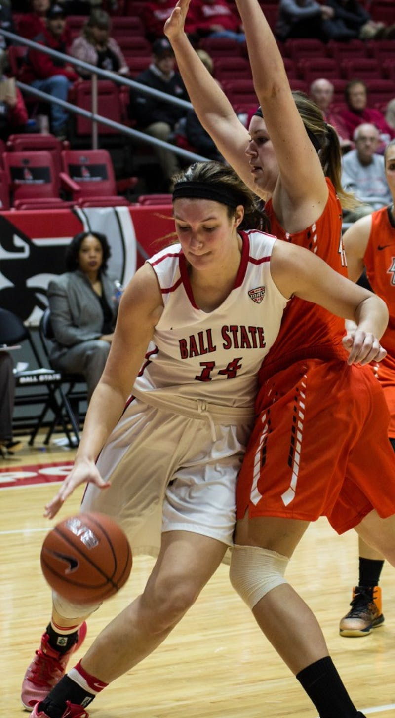 Senior center Renee Bennett attempts to get past a Bowling Green player to shoot a layup during the game on Feb. 8 in Worthen Arena. The Cardinals won 91-70. Grace Ramey // DN