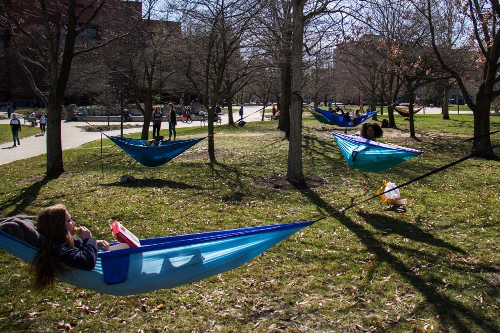 <p>Students set up hammocks to relax in the warm weather on Ball State's campus. Hammocking is one of the 50 items to check off the bucket list. <strong>Eric Pritchett, DN</strong></p>