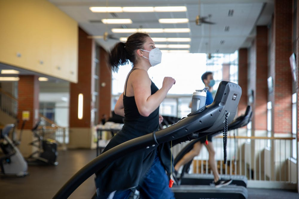 <p>Junior theater major Emma Grow runs on the treadmill Feb. 22, 2021, at Jo Ann Gora Recreation and Wellness Center. If you choose to workout indoors at a gym, the CDC recommends to keep your workouts as brief as possible to avoid prolonged exposure. <strong>Jaden Whiteman, DN</strong></p>