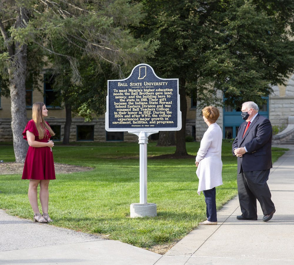 <p>Ball State Board of Trustees Student Member Amy Wyse reads the new historical marker during the unveiling ceremony Sept. 30, 2021. The marker celebrates Ball State&#x27;s centennial, achieved in 2018. <strong>Eli Houser, DN</strong></p>