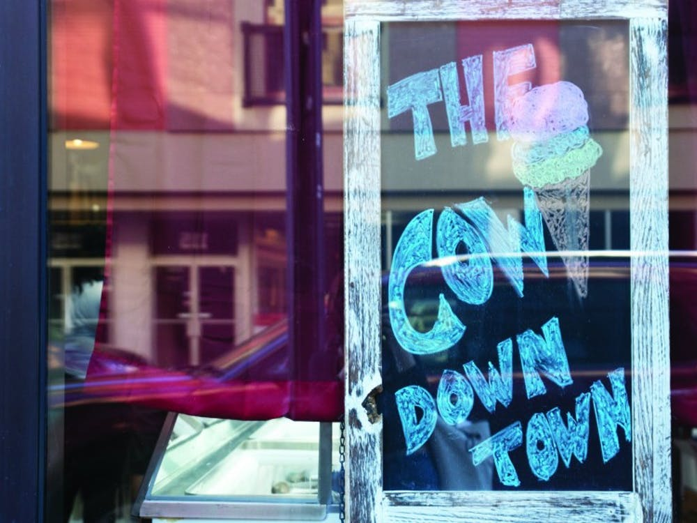 "A sign in the window of The Barking Cow displays the ice cream shop's nickname, ""The Cow Downtown."" Manager Danielle Woodson gave this nickname to The Barking Cow because in Gaston, locals call the ice cream shop, ""The Cow."" Pauleina Brunnemer, DN"