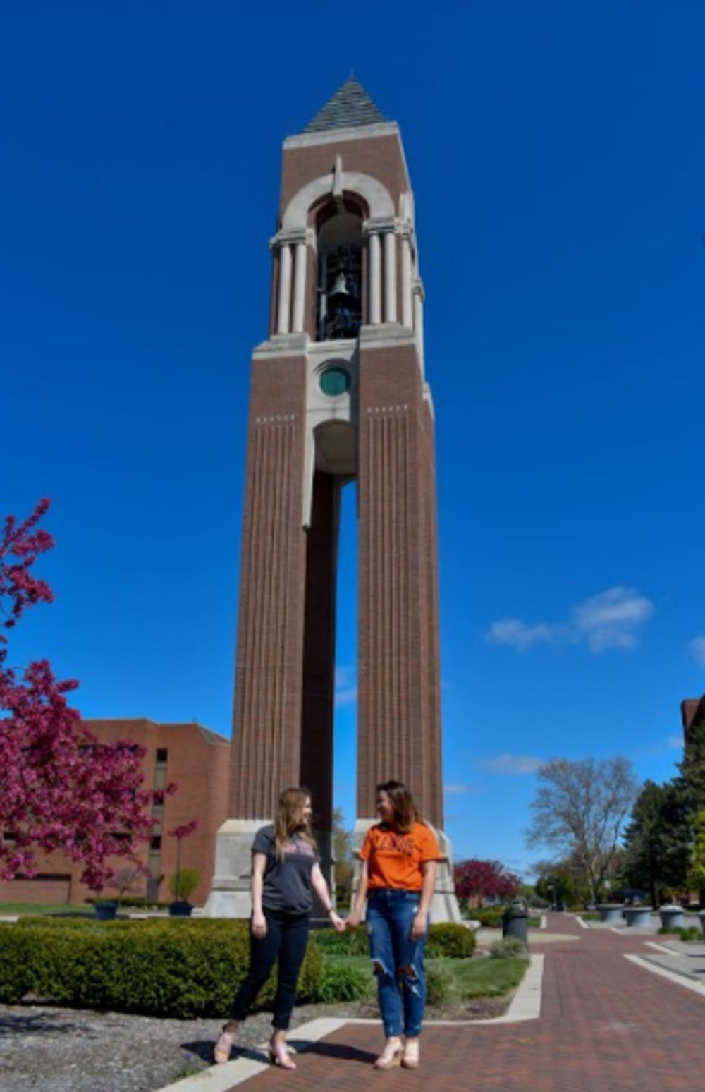 <p>Maddy Hamp and Kelsey Friis pose in front of Shafer Tower on McKinley Ave. Hamp and Friis have been friends since their freshman year at Ball State. <strong>Maddy Hamp, Photo Provided</strong></p>