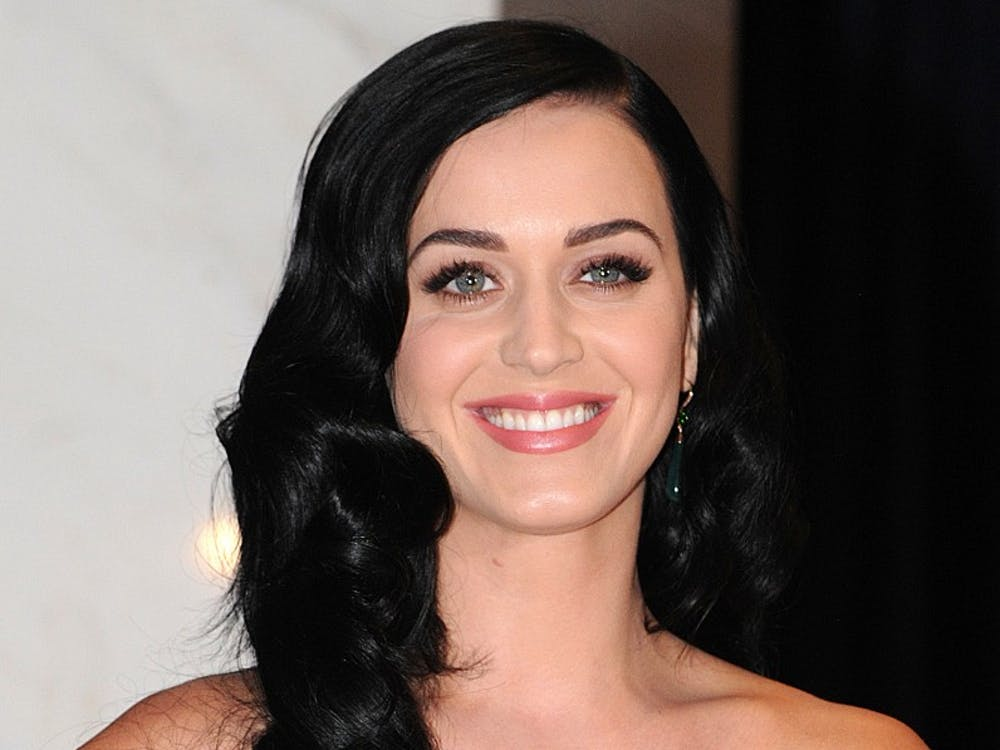 Katy Perry arrives for the White House Correspondents' Association dinner in Washington, D.C., on Saturday, April 27, 2013. The 99th annual dinner raises money for scholarships and honors the recipients of the organization's journalism awards. MCT PHOTO